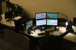 A station in the communications room of the consolidated communications center.  Photo by Chris Yow