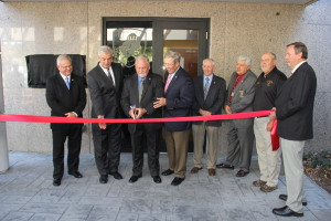 Director Howard Summerford cuts the ribbon at the new E-911 Consolidated Communications Center in Center Point.  Photo by Chris Yow