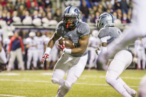 Clay-Chalkville running back A.J. Walker (5) carries the ball against Homewood in the Class 6A state playoffs in Cougar Stadium. Photo by Ron Burkett