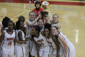 Hewitt-Trussville hoisting the Bryant Bank Thanksgiving Classic hardware following their 57-54 win over Fort Payne on Tuesday night at home. Photo by Erik Harris