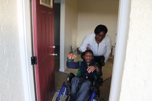 Donavon Dixon in the doorway of his new handicap-accessible home. Photo by Chris Yow