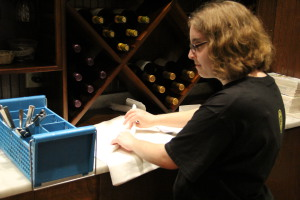 Taylor Cosby, a special needs employee at Trussville Taziki's, rolls silverware. Photo by Chris Yow