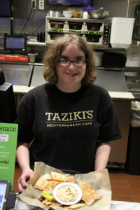 Taylor Cosby shows off an appetizer from Tazikis menu. Photo by Chris Yow