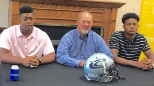 Cougars coach Jerry Hood, center, flanked by Keilend Clayton, left, and Nico Collins, right, talks to members if the media on Monday at Gardendale Civic Complex during High School Football Media Days. Photo by David Knox