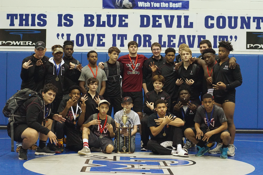 The Pinson Valley Wrestling team poses with their county title trophy. Photo by Danny Joiner