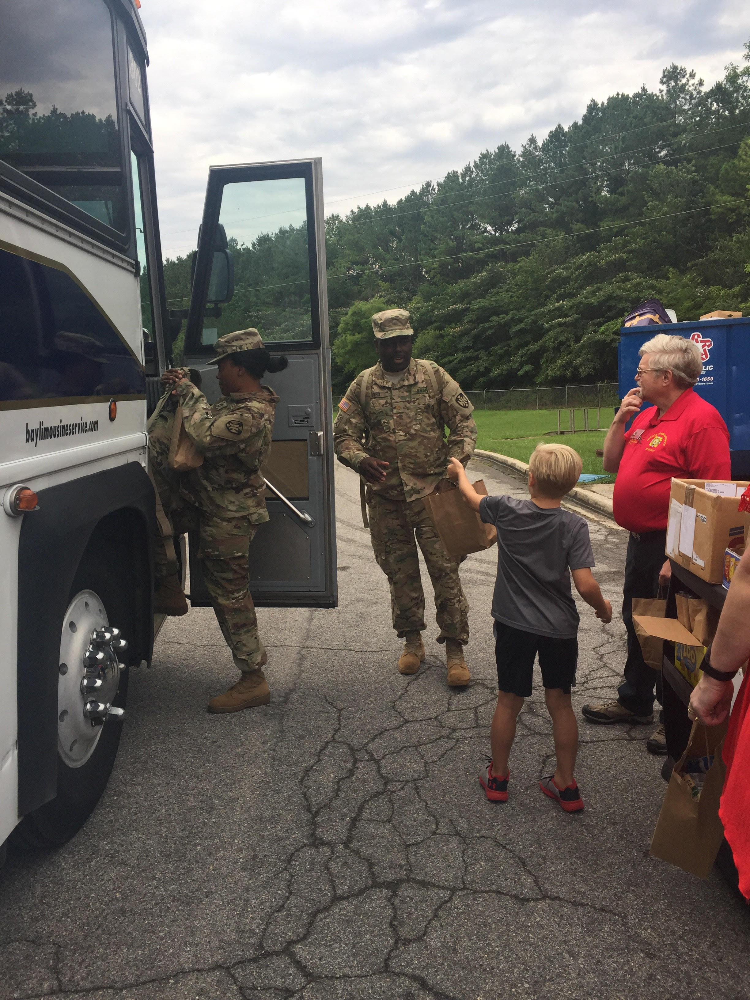 Family serves country by gathering greeting cards for soldiers lucian hands a goodie bag to a soldier boarding a bus for deployment photo by jennifer nelson m4hsunfo