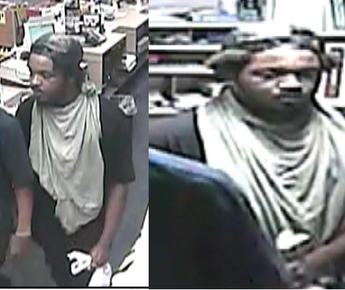 bandit wearing a green sheet around his neck robs cvs police