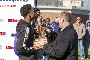 Clay-Chalkville wide receiver T.J. Simmons kisses the Army National Guard national ranking trophy. photo by Ron Burkett