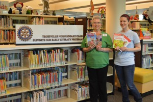 Children's Assistant Karen Davis (left) and Children's Librarian Rebecca Burchfield with a selection of easy readers provided by Trussville Noon Rotary Club. submitted photo