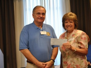 Trussville Chamber Executive Director presents check to Rotary Club