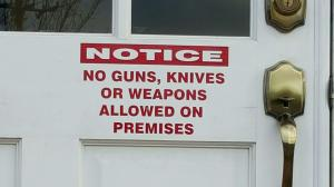 A sign at Clay City Hall prohibits guns, knives or weapons on premises. Photo by Scott Buttram