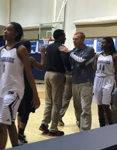 Coach Justin Haynie, right, congratulates Shades Valley coach Gary Ferguson after Clay-Chalkville lost a hard-fought 61-59 game in a Northeast Sub-Regional at Clay on Monday. Photo by David Knox/The Trussville Tribune