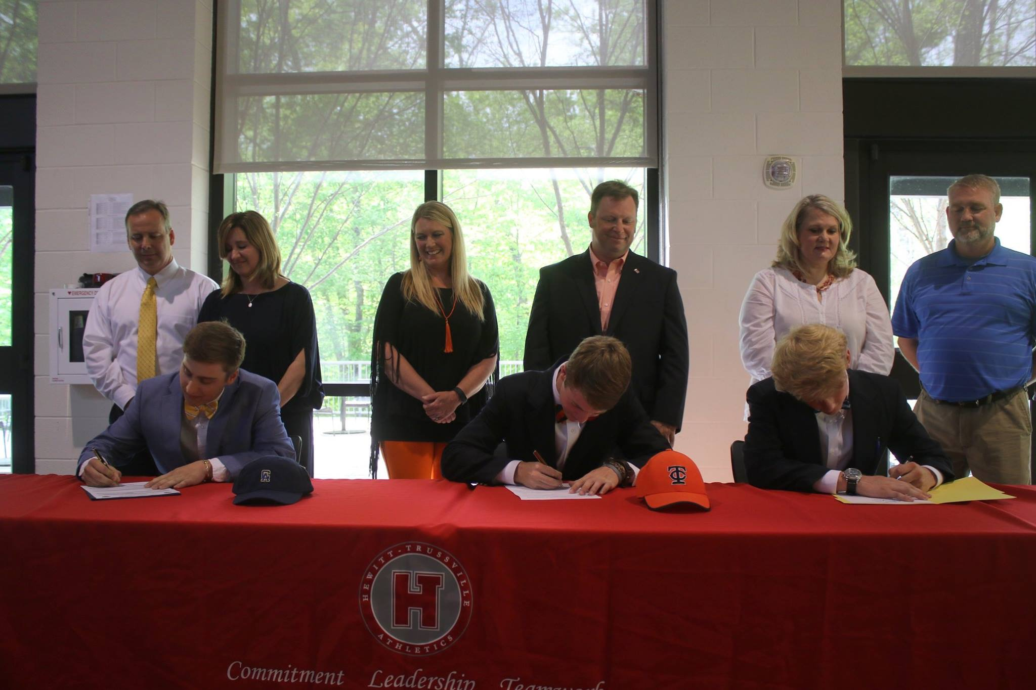 HTHS lacrosse players sign to play at collegiate level