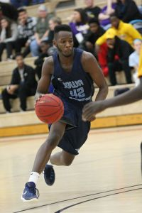 Marcus Baldwin drives during a game for the Iowa Central Tritons. Photo courtesy ICCC.