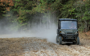 A cloud of dust trails Josh Cornett of Toxey as he runs his spreader-rigged ATV through a small food plot in Choctaw County.