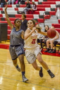 Hewitt-Trussville's Bailey Berry drives to the basket with Clay-Chalkville's Erica Lockahrt defending. Photo by Ron Burkett.