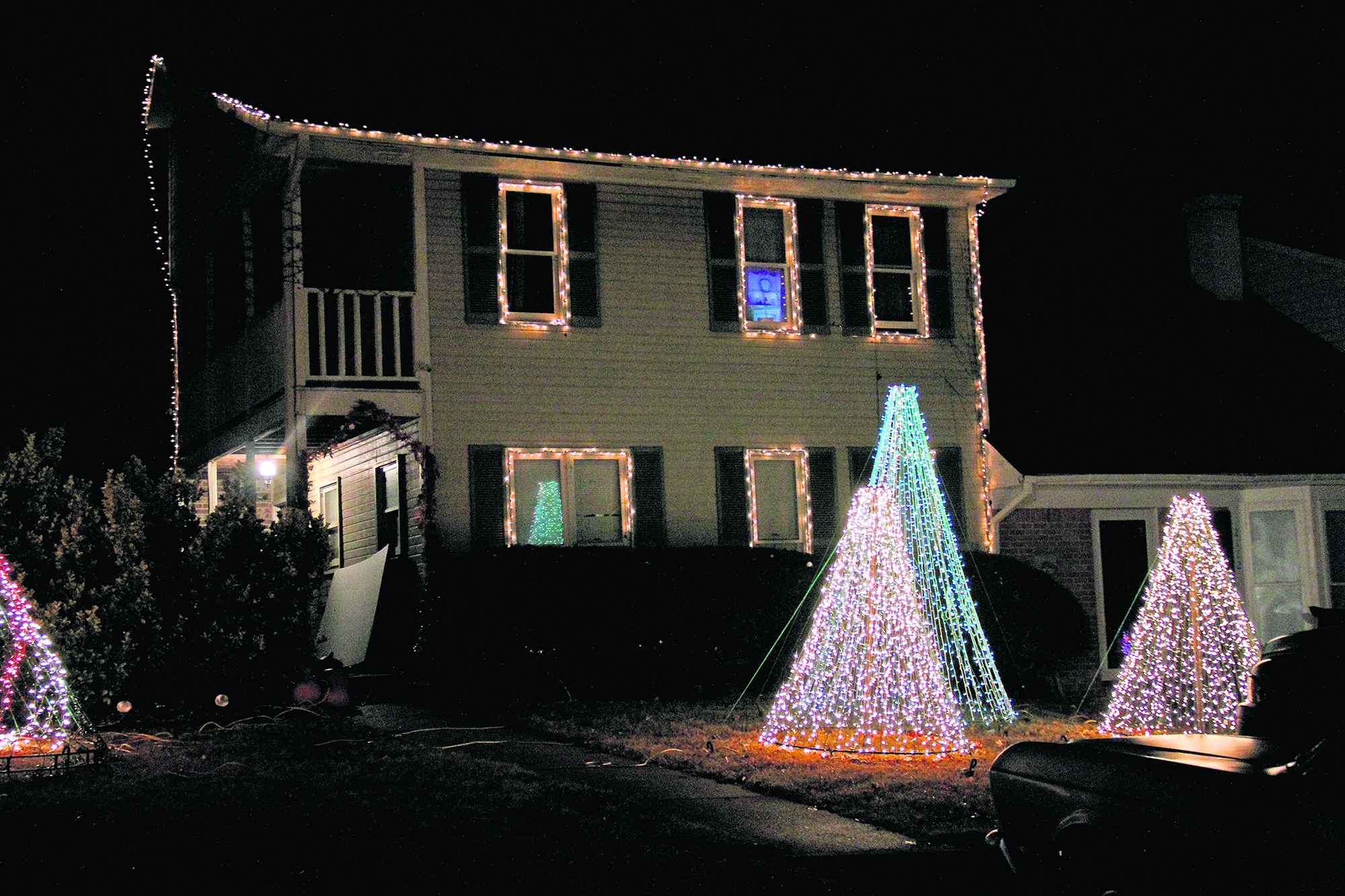 Local family spreading cheer, charity with holiday lights display