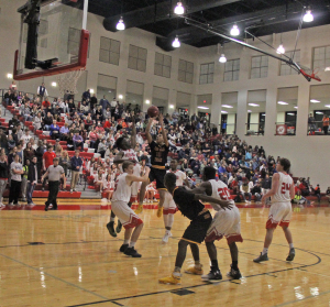 Pinson Valley's Colby Jones goes up for a shot in the lane Friday night at Hewitt-Trussville. Photo by Chris Yow