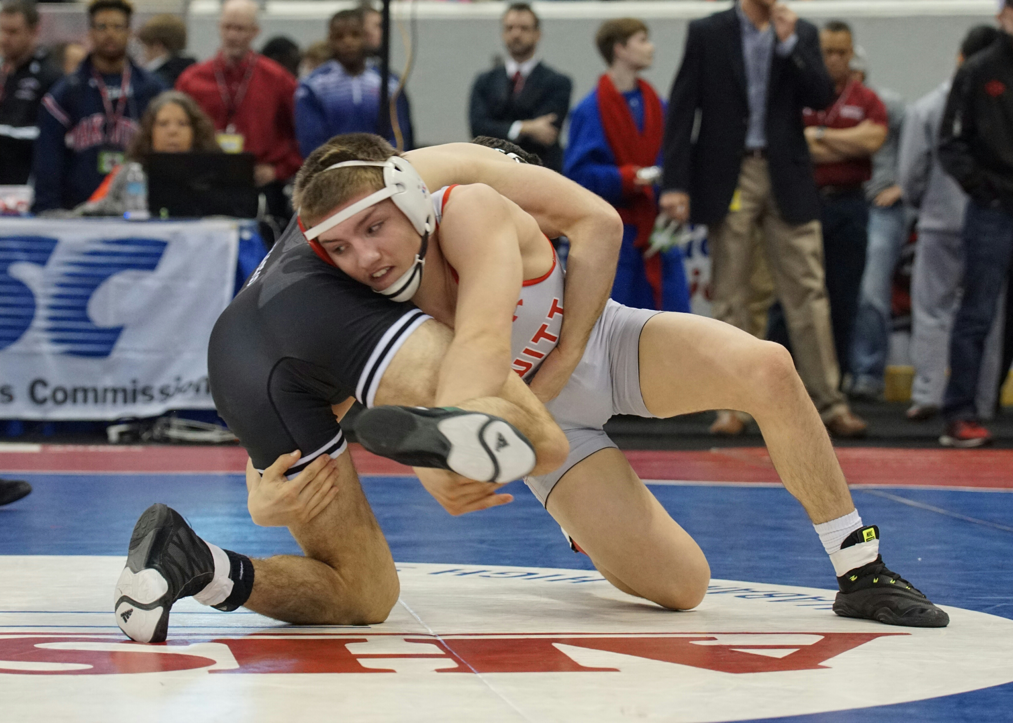 Led by Bob Jones' sectional title, local wrestlers headed to state