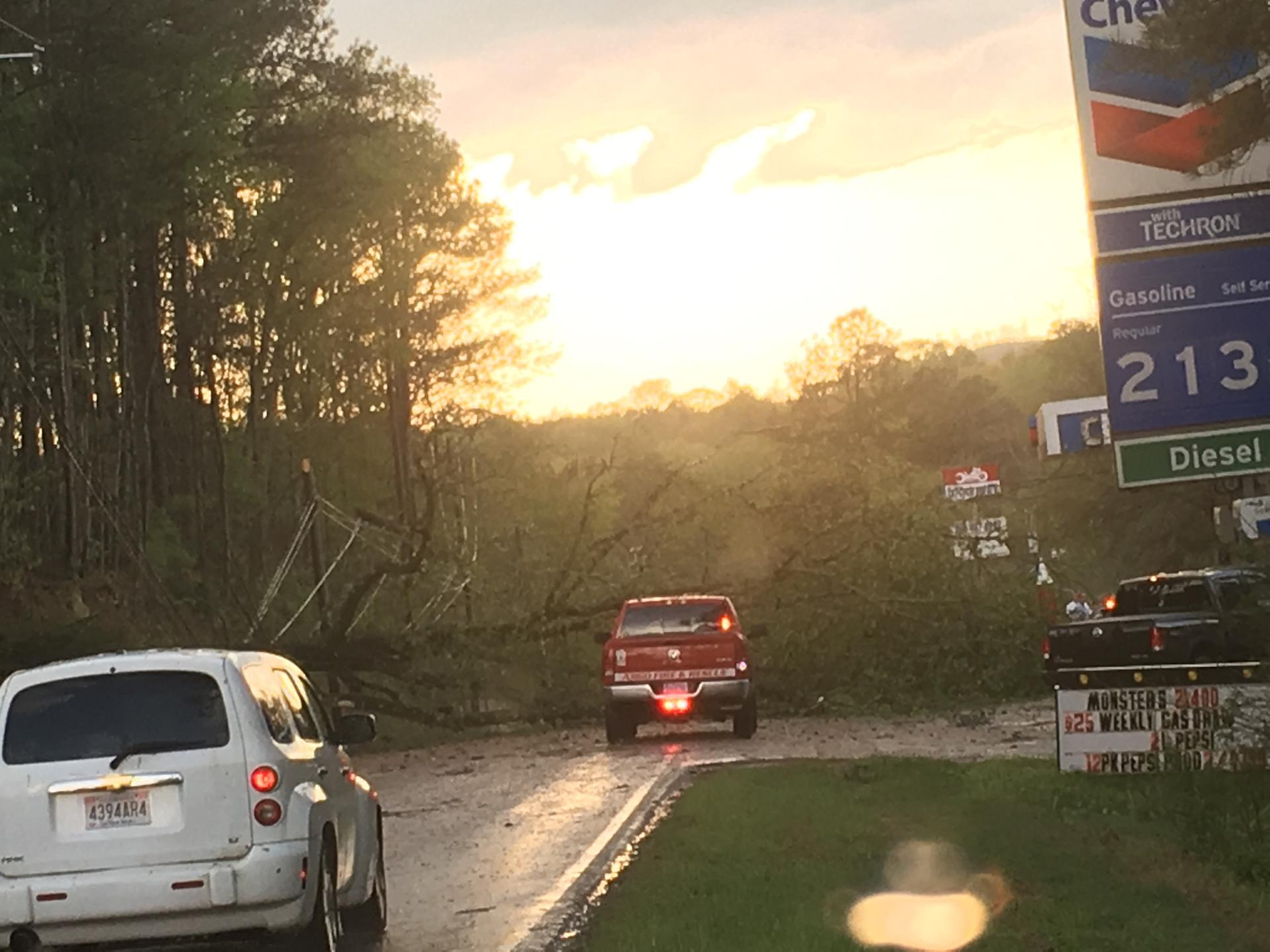 Update: All but one blocked roadway has been cleared of trees and utility lines