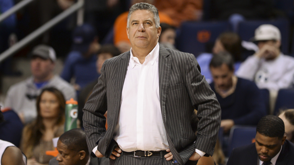 Auburn imposes postseason ban for former assistant's scheme