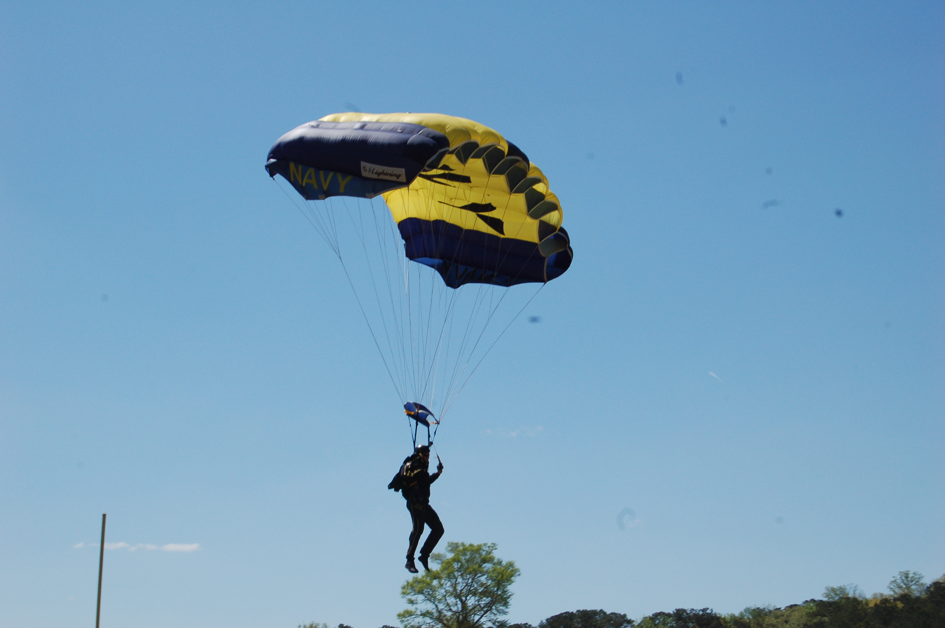 PVHS assistant principal parachutes into football field in Navy SEALs program