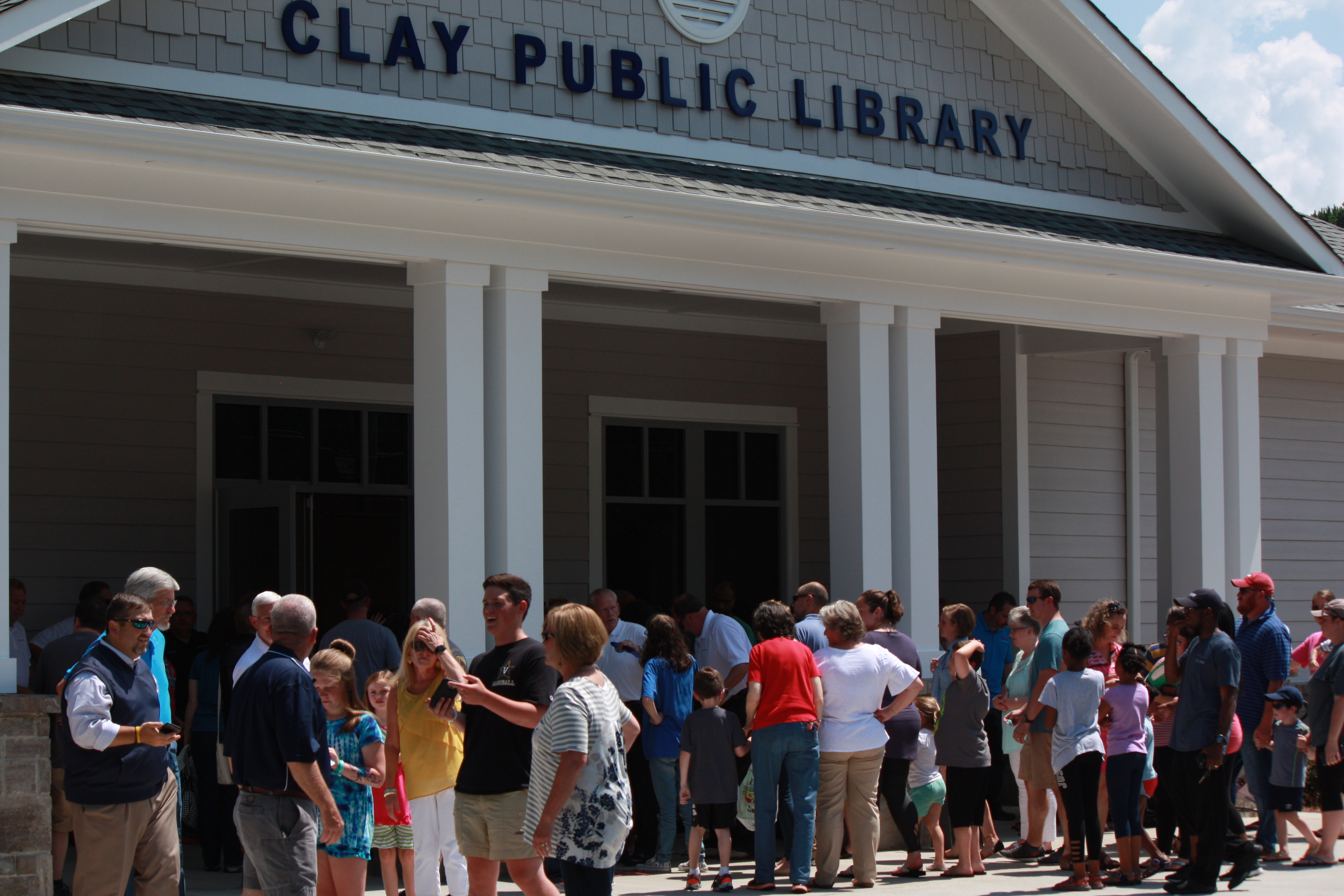 Clay Public Library celebrates opening with ribbon cutting