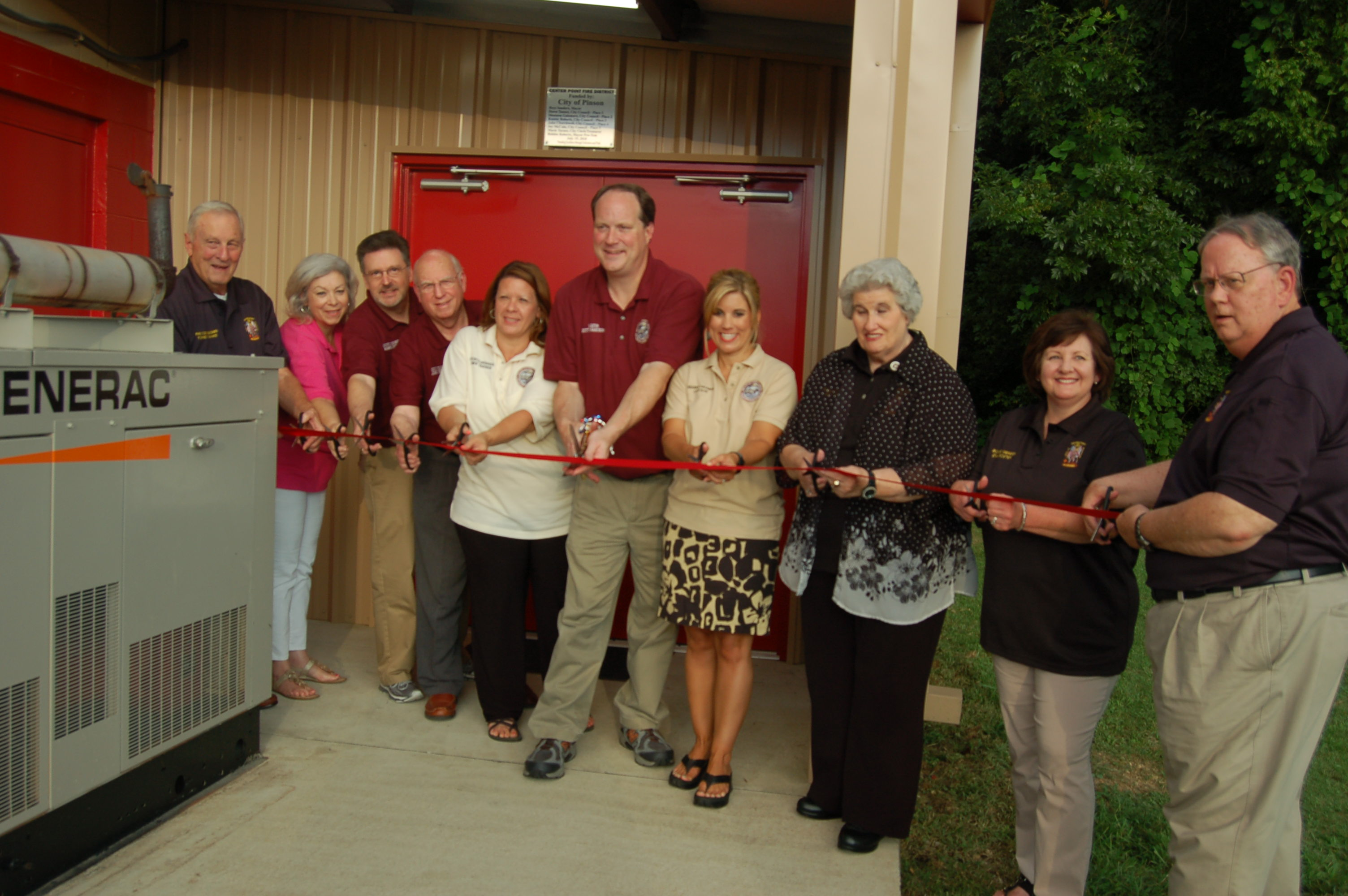 Members of the Pinson City Council about to cut the ribbon for a new clean room at Center Point Fire District 2. Photo by Nathan Prewett.