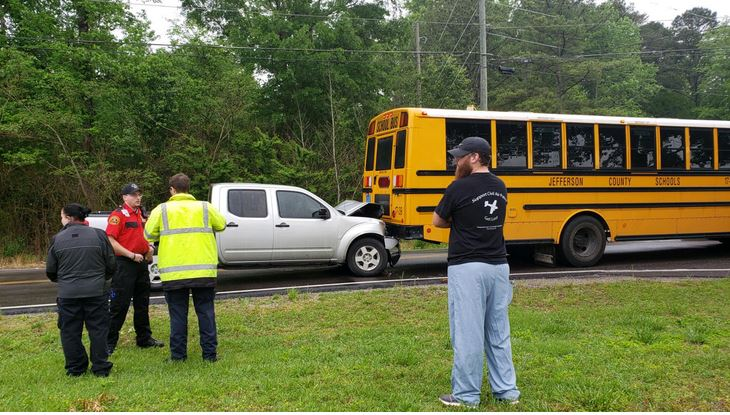 Motor vehicle accident involving school bus and pickup truck on Queenstown Road