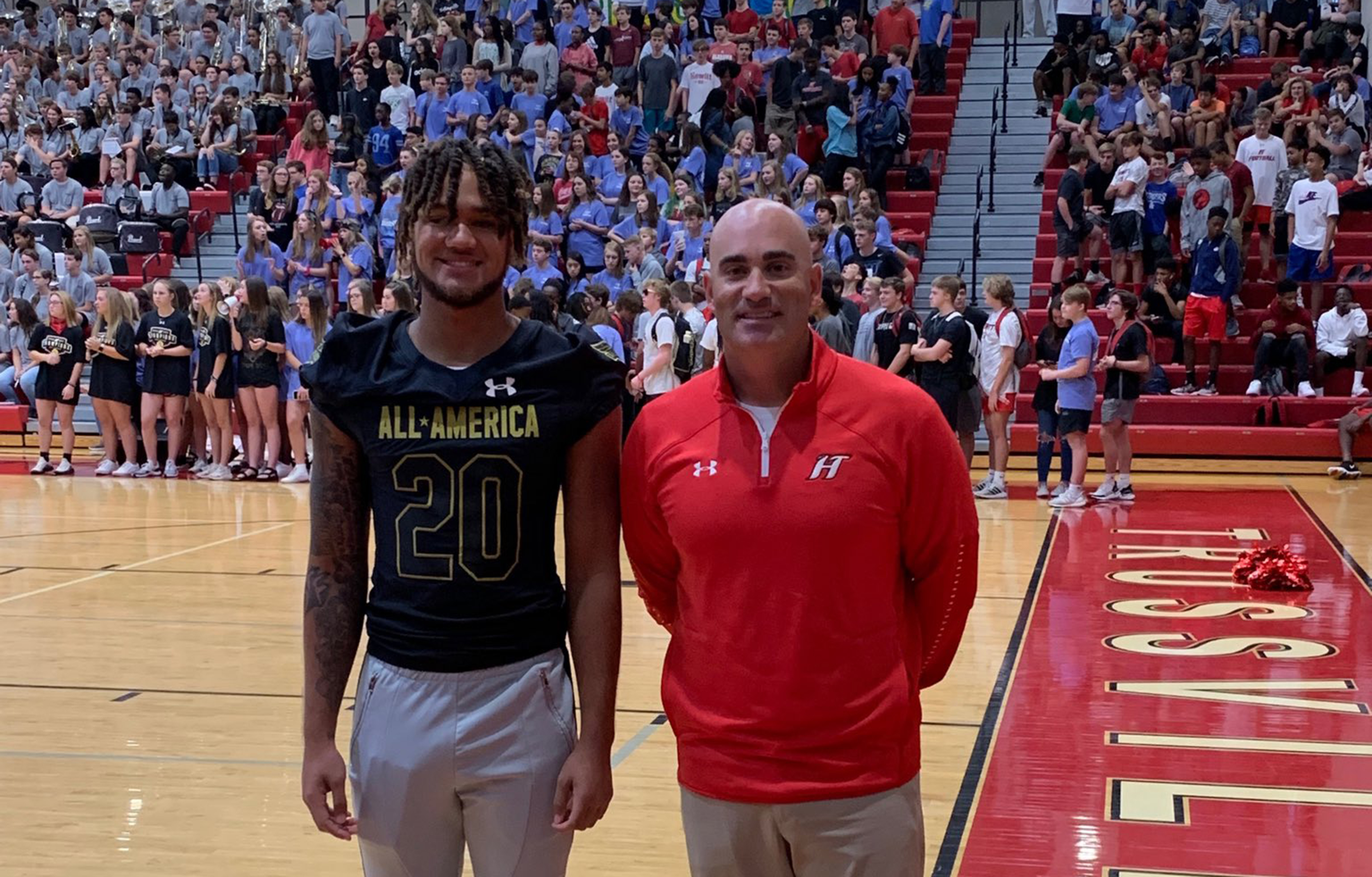 Huskies' Dazalin Worsham presented with Under Armour All-American jersey