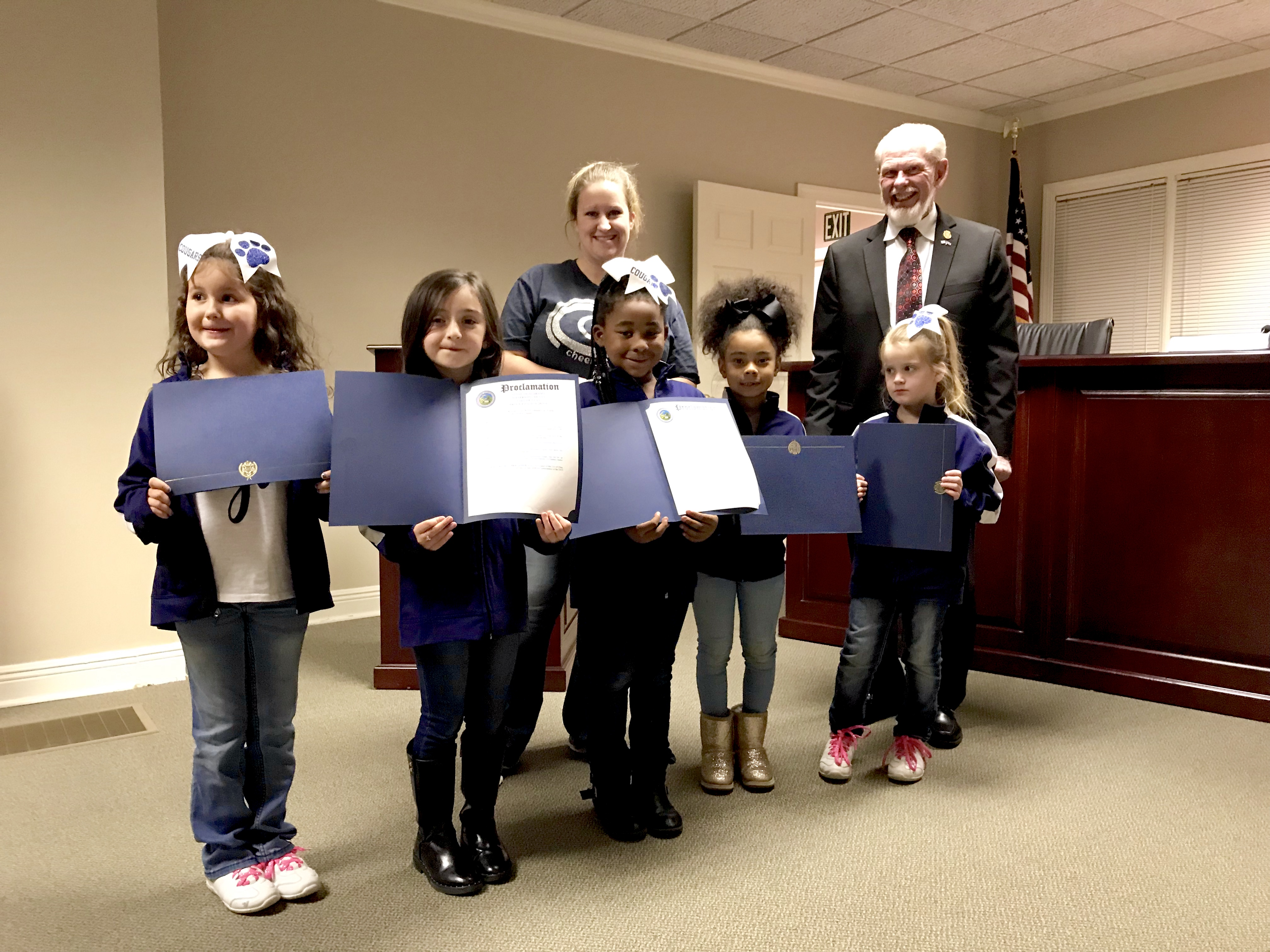 Clay Council recognizes Clay Youth cheerleaders, discusses final rendering of splash pad/playground complex