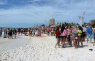 Thousands of spring breakers flock to Florida beaches despite coronavirus threat