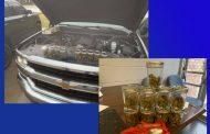 Dora Police find marijuana in mason jars and engine compartment of car