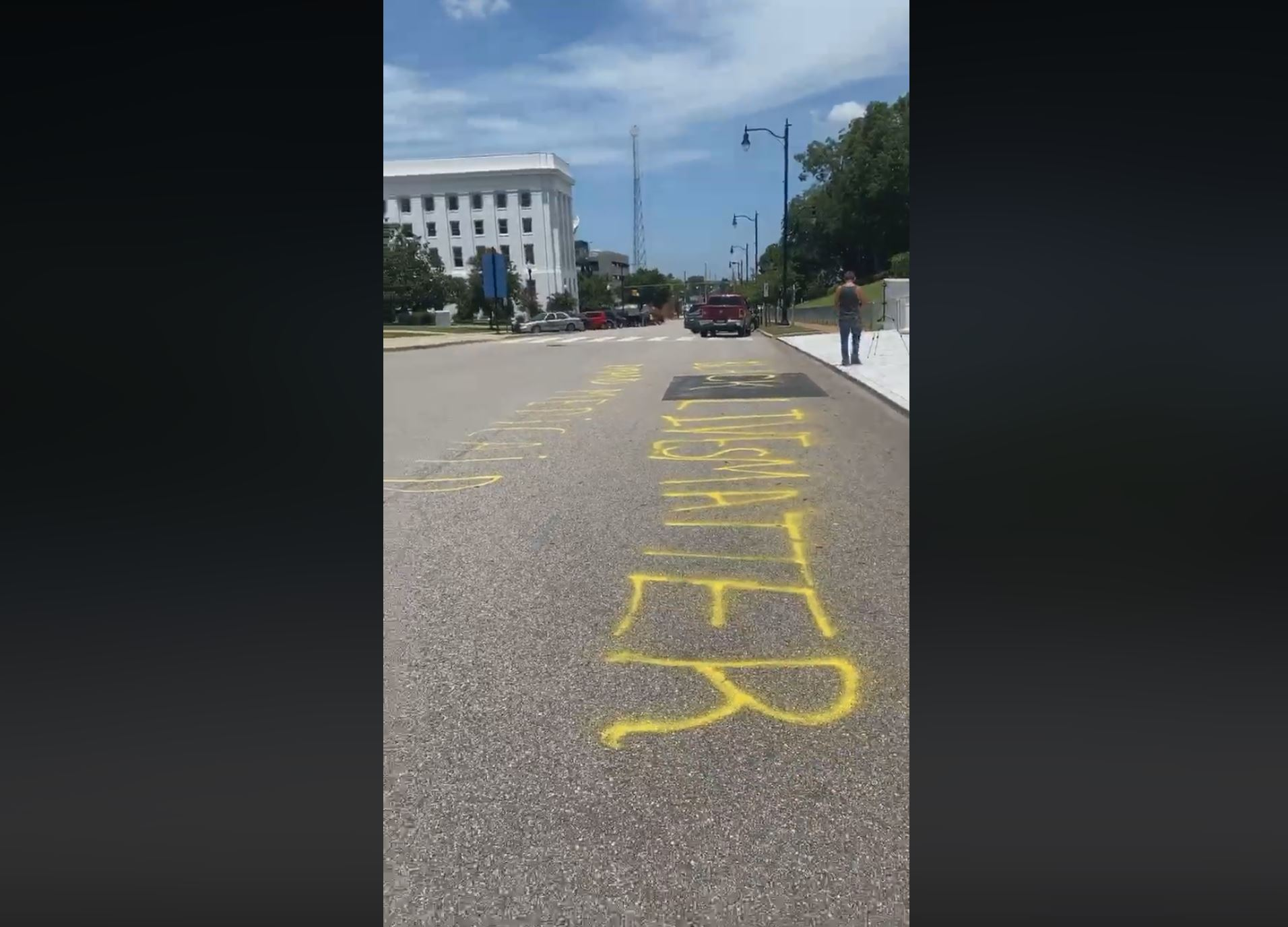 """Black Lives Matter"""" and """"Expand Medicaid"""" painted on street in front of Alabama Capitol"""
