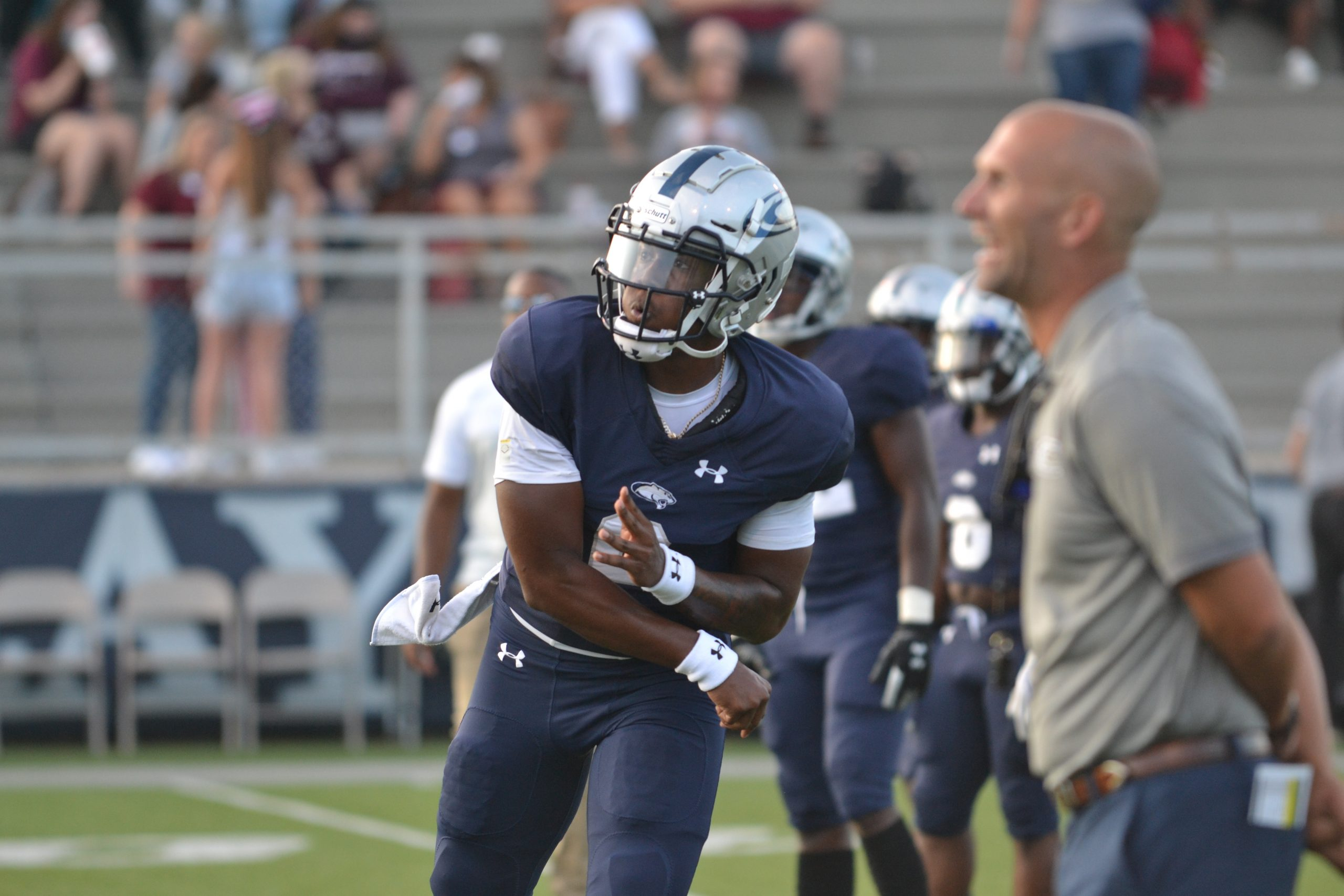 Cougars overcome mistakes to beat minor, 38-33
