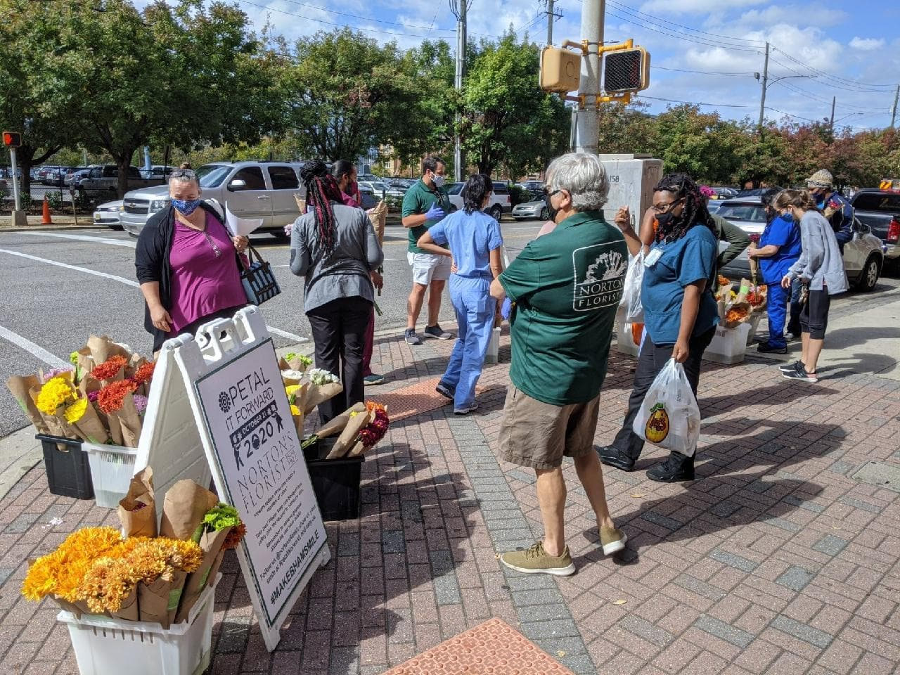Norton's Florist giving away flowers at UAB to put smiles on faces