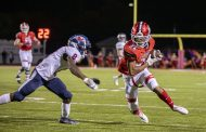 Carruth fires 4 TDs, No. 4 Huskies handle Oak Mountain