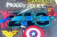 Sidewalk chalk art at Moody church honors local heroes
