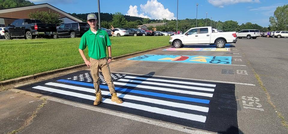Springville senior paints Thin Blue Line flag in parking spot at school